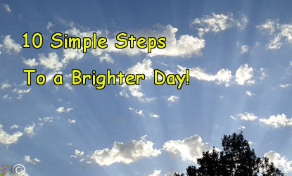 """This was taken by the Positiving Owners. It is a picture of the top of a tree with the sun's streaming rays across a cloud dotted sky. There are the words """"10 Simple Steps To a Bright Day!"""" written on the picture."""